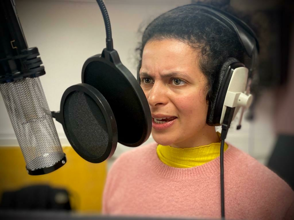Actor recording their voice into a microphone